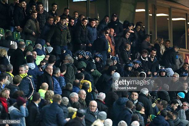 Riot policemen protect Nantes' President Waldemar Kita against angry fans during the Ligue 1 match between Fc Nantes and Toulouse Fc at Stade de la...
