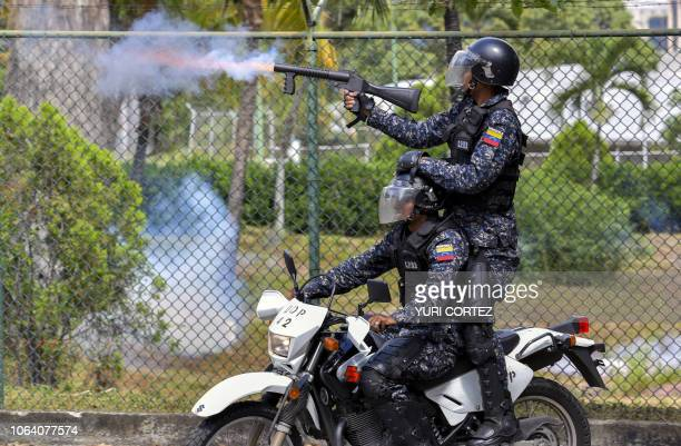 TOPSHOT Riot policemen shoot tear gas at students of Caracas' Central University during clashes within a demonstration marking the University Student...