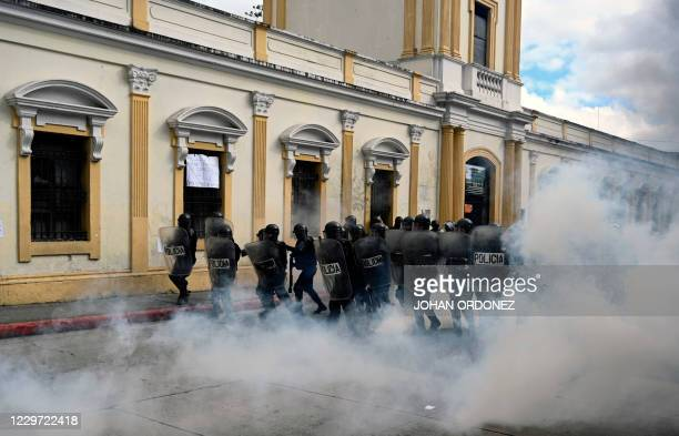 Riot policemen take position during a protest demanding the resignation of President Alejandro Giammattei, in Guatemala City on November 21, 2020. -...