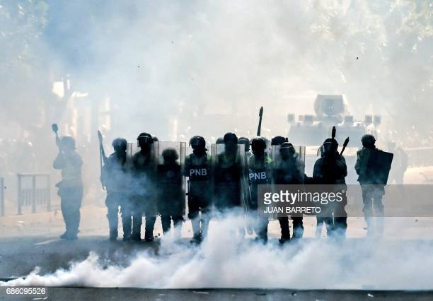 TOPSHOT Riot policemen take positions during an opposition protest against the government of President Nicolas Maduro in Caracas on May 20 2017...
