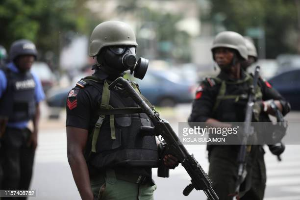 Riot policemen wearing masks stand in a street during a violent protest of Shiite Muslims demanding the release of their detained leader Ibrahim...