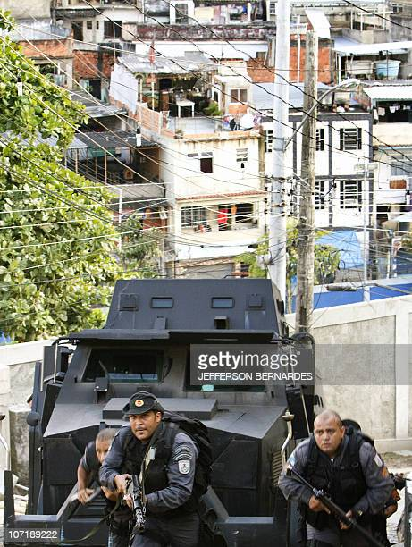 Riot Special Forces advance as they invade the Morro do Alemao shantytown on November 28 2010 in Rio de Janeiro Brazil After days of preparation...