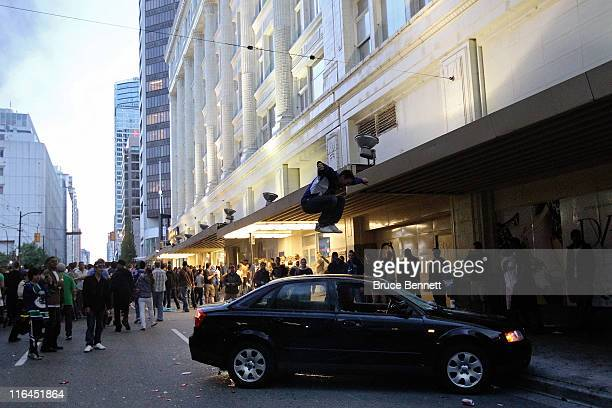A rioter jumps on the top of a car on June 15 2011 in Vancouver Canada Vancouver broke out in riots after their hockey team the Vancouver Canucks...