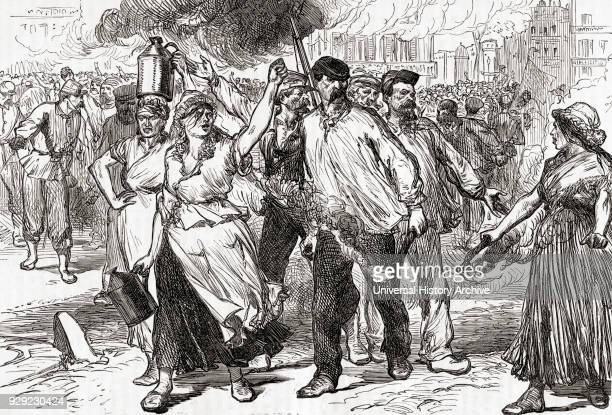 Rioters and Pétroleuses female supporters of the Paris Commune firing public buildings in Paris France during the last days of the Commune May 1871...