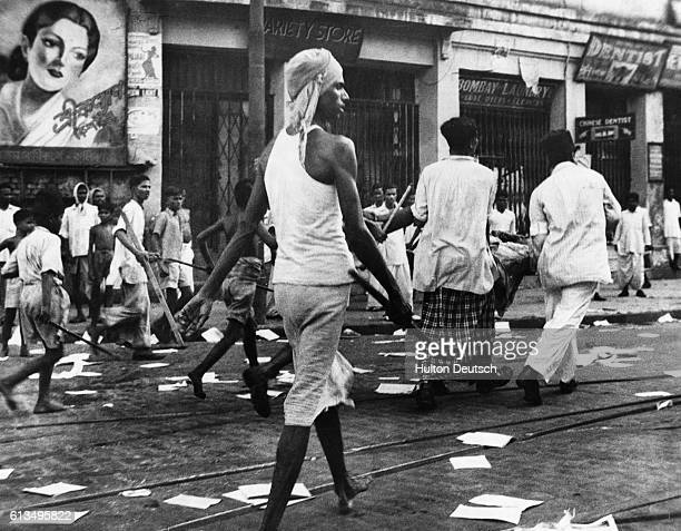 Rioters armed with lathis on the streets of Calcutta So far over 2000 people have been killed and at least 4000 have been injured in communal riots...