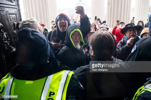 Rioters attempt to enter the Capitol at the House steps during a joint session of Congress to certify the Electoral College vote on Wednesday,...