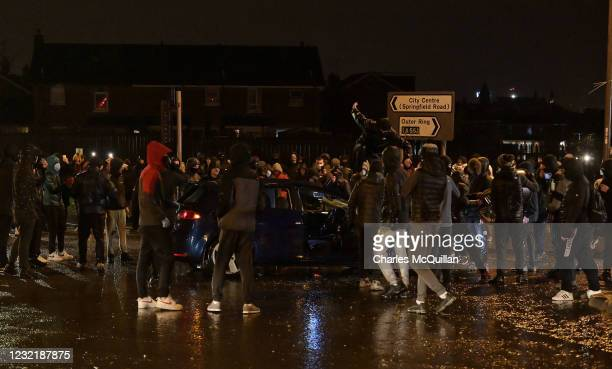 Rioters attempt to set a car on fire as nationalists attack Police on Springfield Road just up from Peace Wall interface gates which divide the...