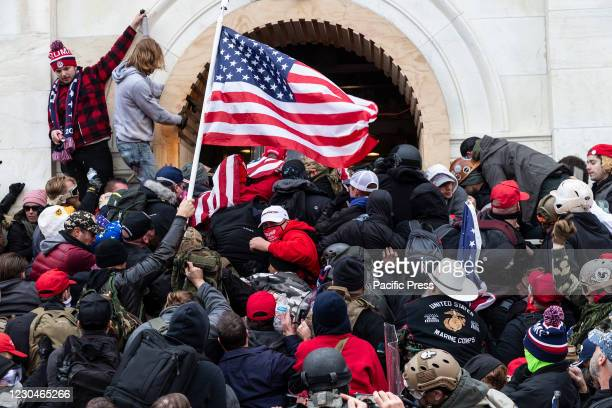 Rioters clash with police trying to enter Capitol building through the front doors. Rioters broke windows and breached the Capitol building in an...
