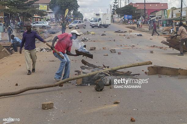 Rioters light bonfire during demonstrations on a road in Kasangati on July 9 2015 The demonstration started after two presidential hopefuls former...