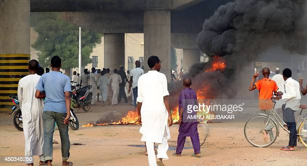 Rioters light fires on the streets of northern Nigeria's ancient city of Kano in protest over the appointment of Nigeria's former Governor of the...