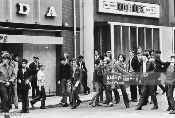 Rioters throwing rocks and stones as trouble flared following the annual Apprentice Boys parade through the streets on Derry, Northern Ireland, 13th...