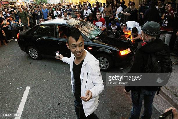 Rioters try to flip a car on June 15 2011 in Vancouver Canada Vancouver broke out in riots after their hockey team the Vancouver Canucks lost in Game...