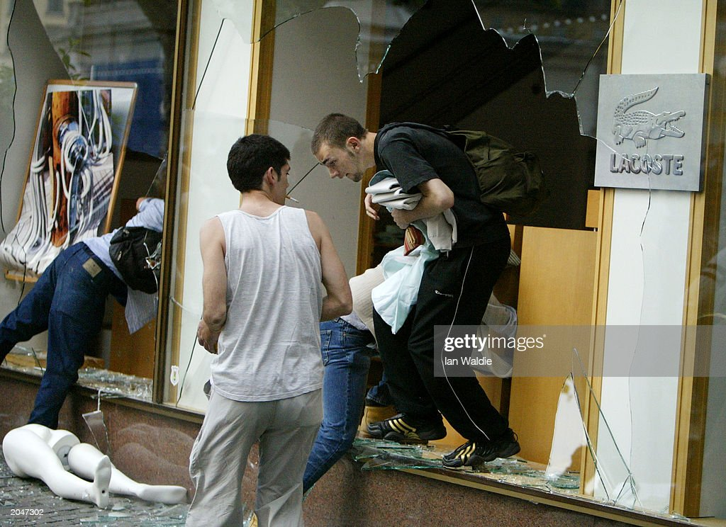 Rioters vandalize and loot a clothing store during protests June 1, 2003 in Geneva, Switzerland. After thousands of protesters rallied against the G8 summit being held in nearby Evian, France, demonstrations turned violent later in the day as storefronts were smashed and police fired tear gas in the center of Geneva.