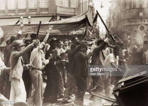 Rioting in Rio de Janeiro after the disputed election of 1930 which elected government candidate Julio Prestes to the presidency amid accusations of...