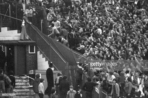 Rioting Tottenham Hotspur fans tear down a section of iron railings in a bid to reach the Chelsea supporters before a Division One game at London's...