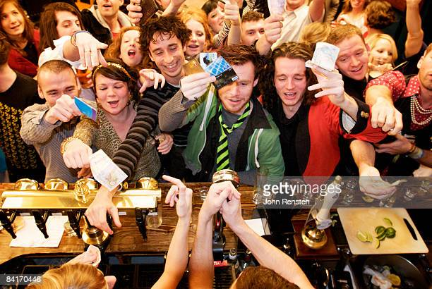 riotous drinking party in public bar  - busy stock pictures, royalty-free photos & images
