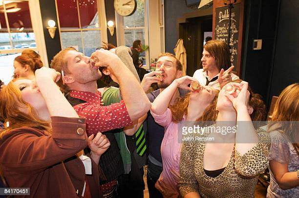 riotous drinking party in public bar  - passed out drunk stock pictures, royalty-free photos & images