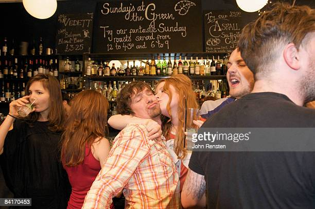 riotous drinking party in public bar  - drunk stock pictures, royalty-free photos & images
