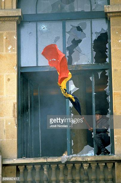 Riots and street violence led the Romanian dictator Nicolae Ceausescu to abandon power and flee Bucharest with his wife Deputy Prime Minister Elena...