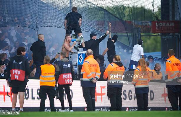 Riots at the FC Copenhagen fan stand with stewards and guards on the pitch during the Danish Alka Superliga match between Brondby IF and FC...