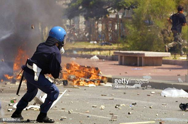 Riots on the second day of the G8 Summit in Genoaviolent clashes broke out between the antiglobalization demonstrators and the Italian police
