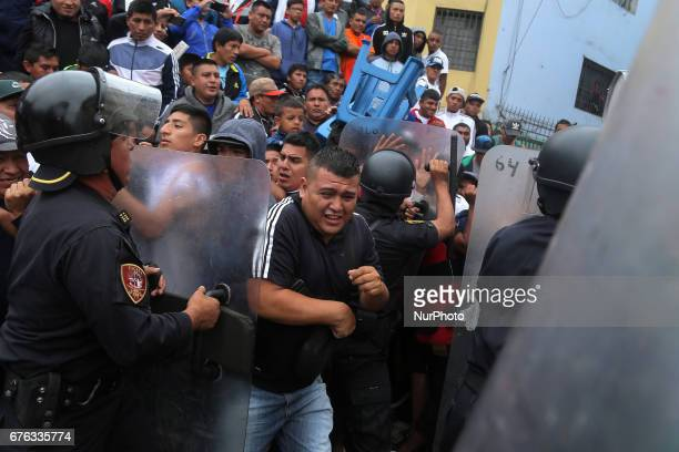 Riots police clash during the street football match in Lima Peru May 1 2017 For 64 years every May 1st is celebration the Mundialito de El Porvenir...