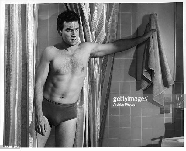 Rip Torn coming out of the shower in a scene from the film 'Critic's Choice' 1963
