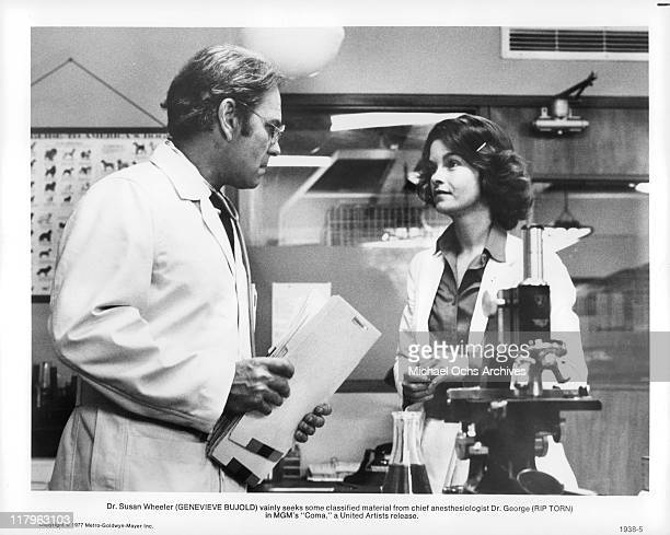 Rip Torn talks with Genevieve Bujold in a scene from the film 'Coma' 1977