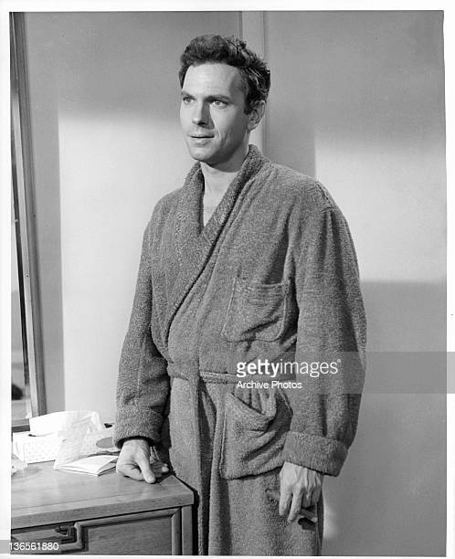 Rip Torn wearing a bathrobe in a scene from the film 'Critic's Choice' 1963