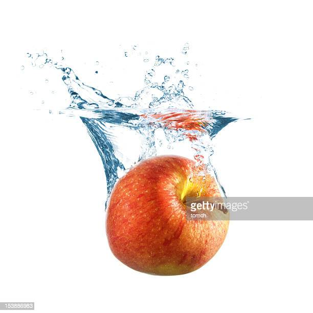 ripe apple fall into water - apple fruit stock pictures, royalty-free photos & images