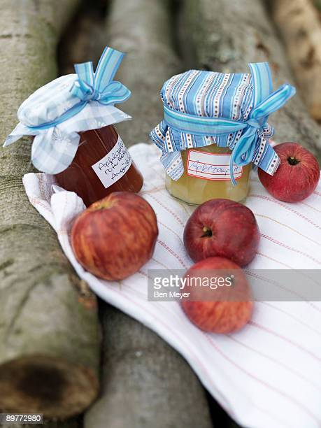 Ripe Apples and jam on log pile