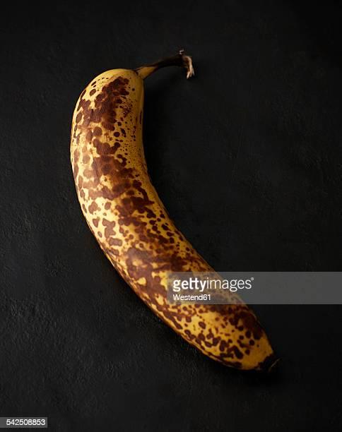 Ripe banana on black background