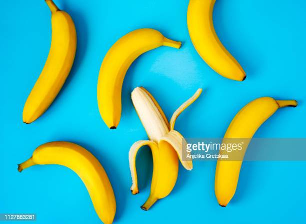 ripe bananas on blue background - banana fotografías e imágenes de stock