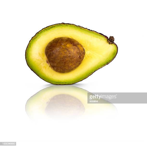 Ripe bisected avocado isolated on white background