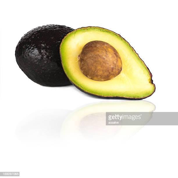 Ripe halved and whole avocado isolated on white background