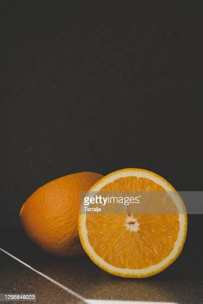ripe juicy orange cut half gray