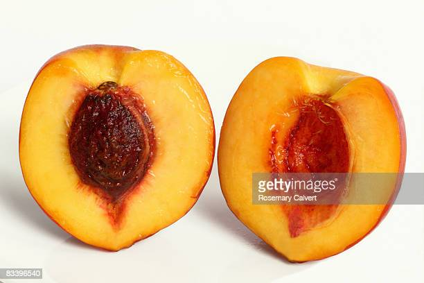 Ripe nectarine cut in half to reveal the stone.