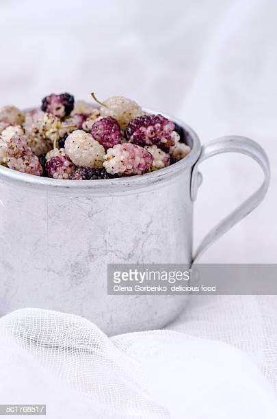 Ripe organic mulberry in aluminum cup