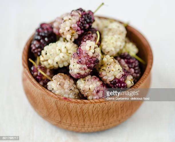Ripe organic mulberry in wooden plate