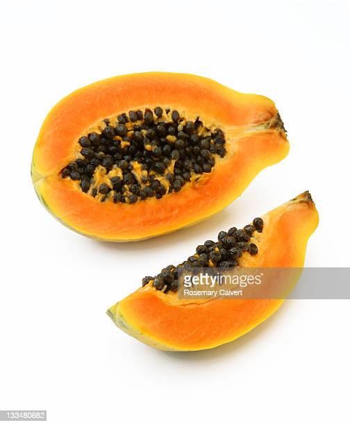 Ripe papaya cut to reveal seeds inside.