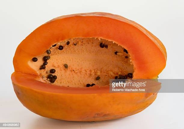 Ripe papaya fruit on white background The fruit is dark orange in color with black seeds