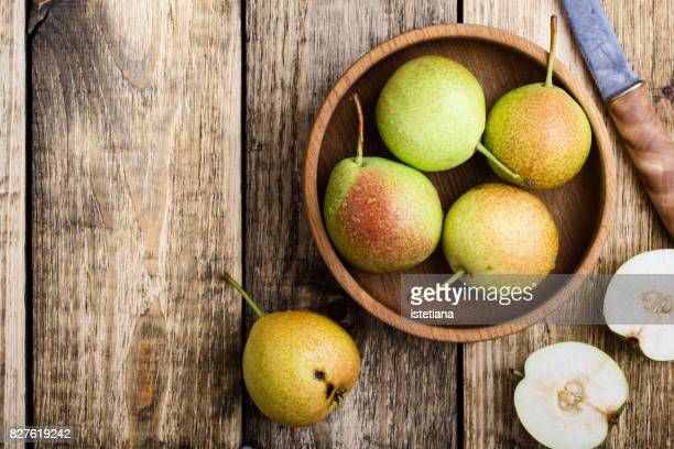 ripe pears on rustic table - pear stock pictures, royalty-free photos & images
