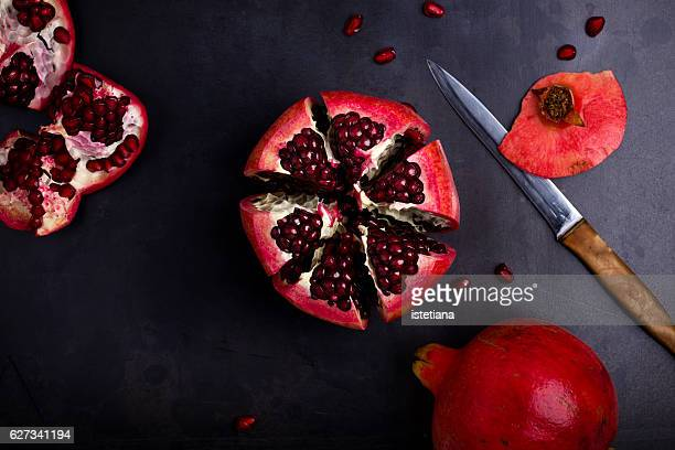 Ripe pomegranate fruit on  vintage background
