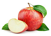 Ripe red apple with slice and leaves isolated on white