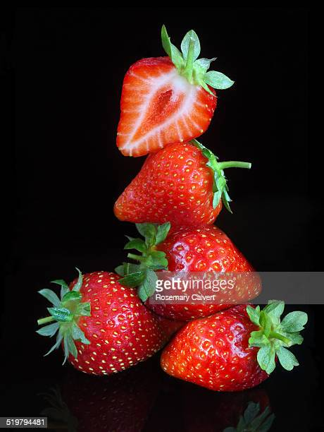 ripe strawberries piled on top of each other. - strawberry stock pictures, royalty-free photos & images