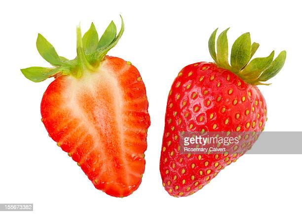 ripe strawberry halves - cross section stock pictures, royalty-free photos & images