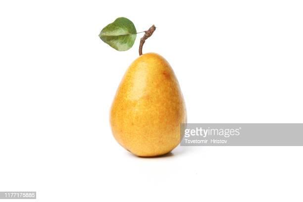 ripe yellow pears on white background - maduro fotografías e imágenes de stock