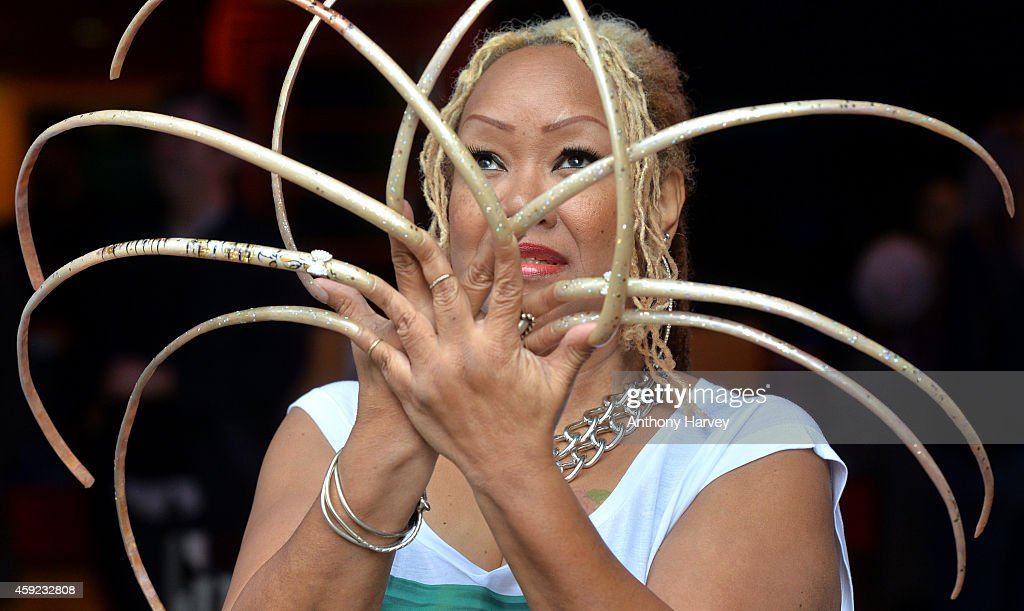Ripley's Believe It Or Not unveil Ayanna Williams, the Woman with 23 inch nails at Ripley's Believe It Or Not on November 19, 2014 in London, England.