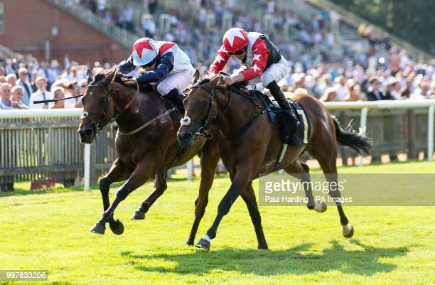 Ripp Orf ridden by Ryan Moore wins the Saeed Suhail Saeed Handicap during day two of The Moet Chandon July Festival at Newmarket Racecourse