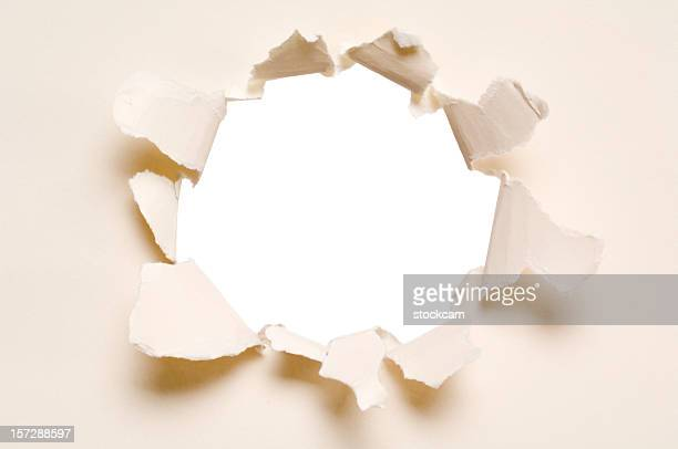 ripped hole in a paper, isolated - appearance stock pictures, royalty-free photos & images